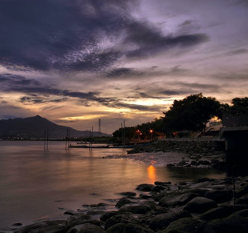 Безкоштовне стокове фото на тему «берег, берег моря, вода, Захід сонця»