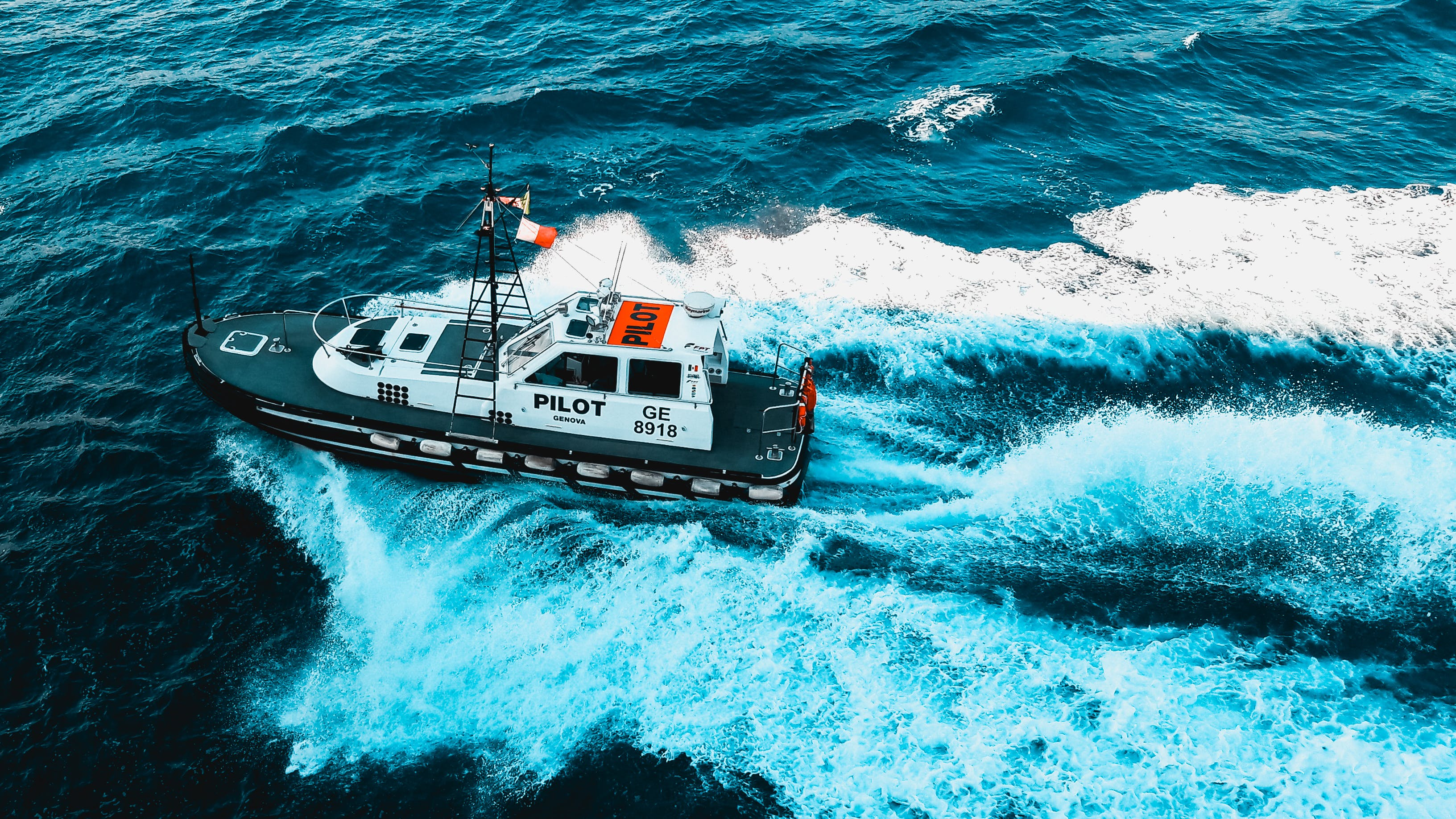 Black and White Pilot Tug Boat on Ocean
