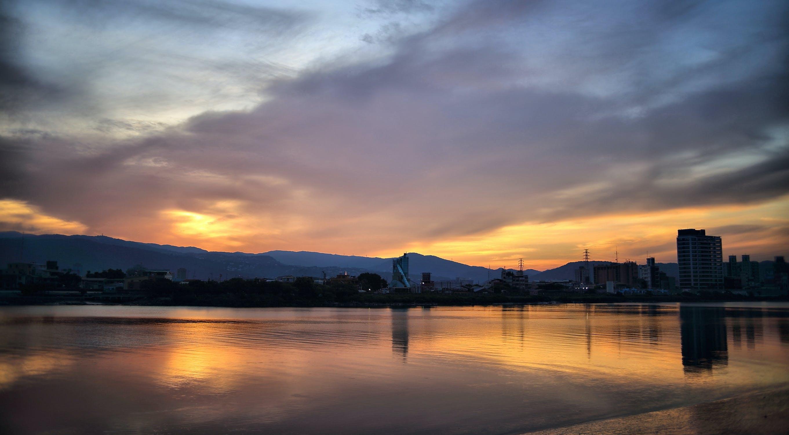 Water Near City Under Grey Cloudy Sky Landscape Photography