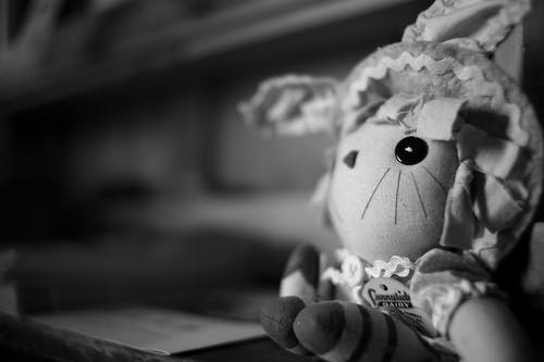 Grayscale Photography of Cartoon Character Plush Toy