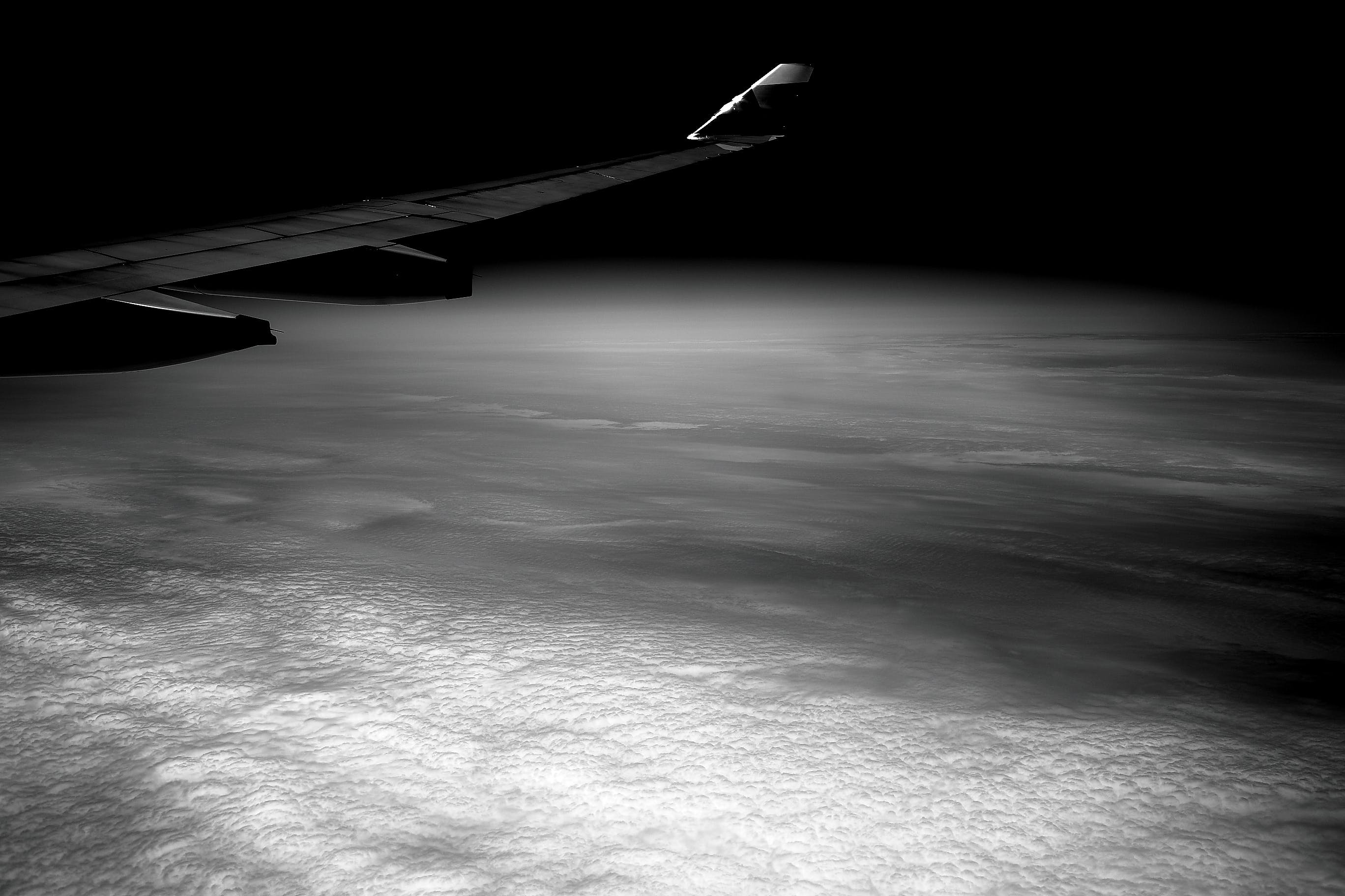 Airplane Wing in Gray Scale Photohraphy