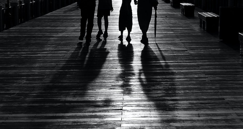 Silhouette of 4 Person Walking