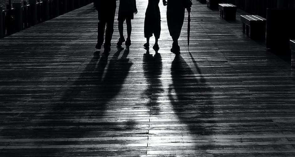 Silhouette Of 4 Person Walking 183 Free Stock Photo