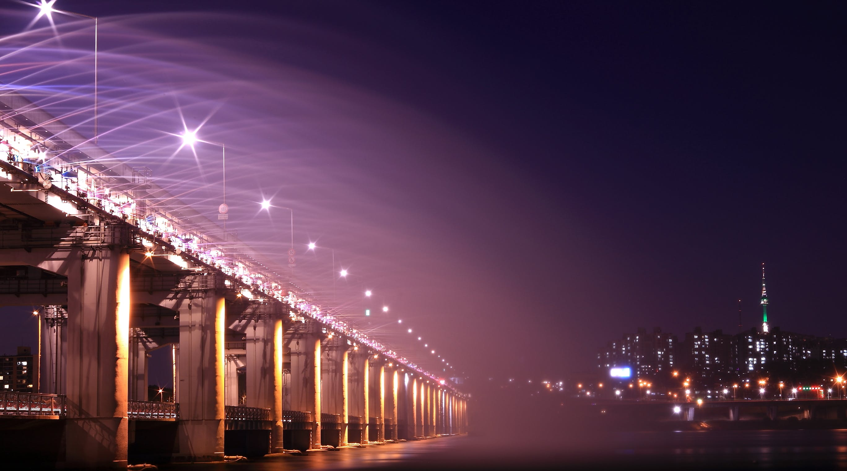 Gray Bridge With Street Light during Nighttime