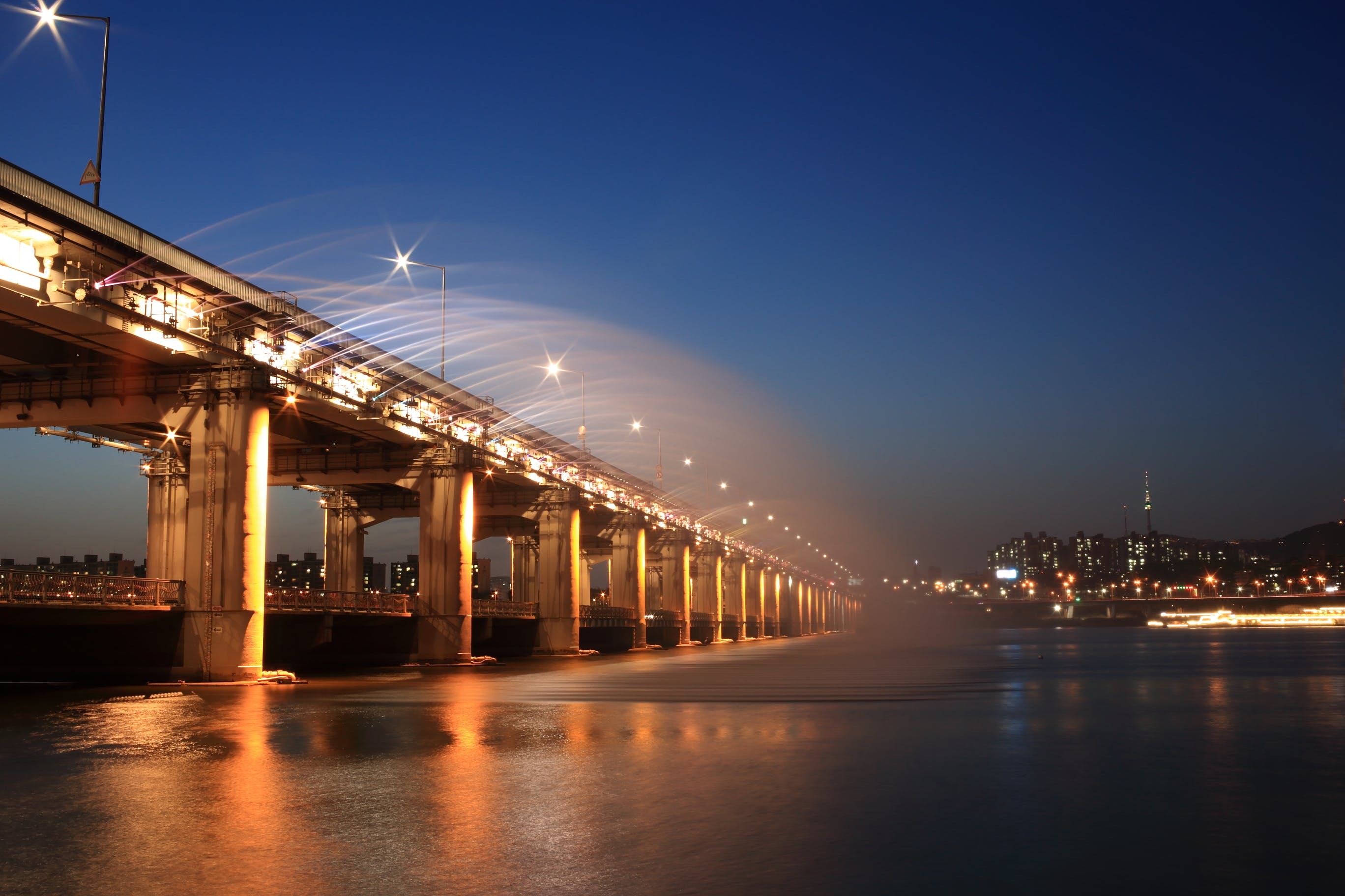 Gray Concrete Bridge With Sprinklers