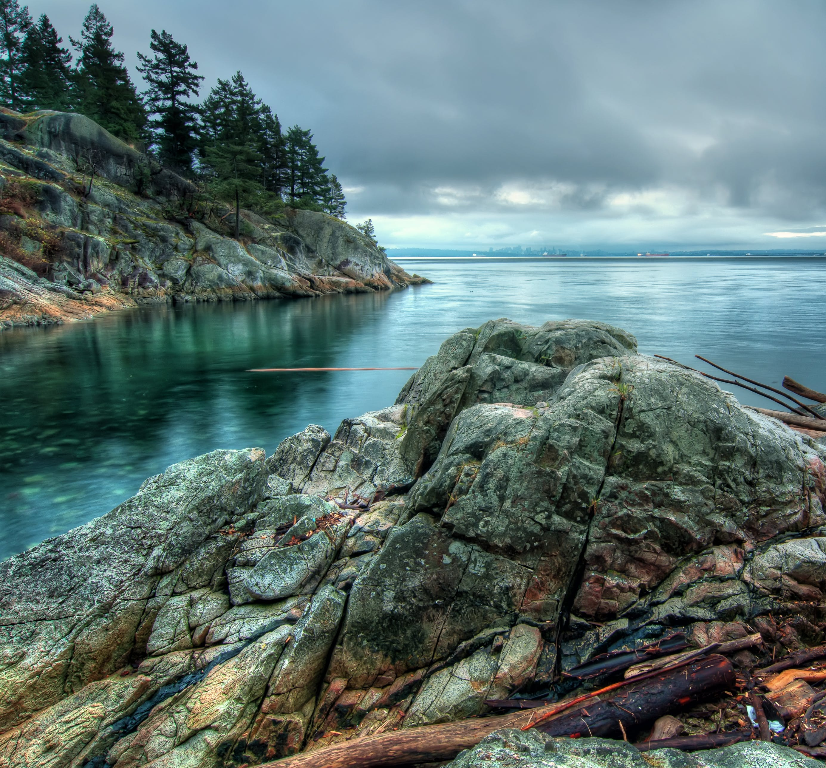 Calm Sea Beside Rock Formation With Trees Nature Photography