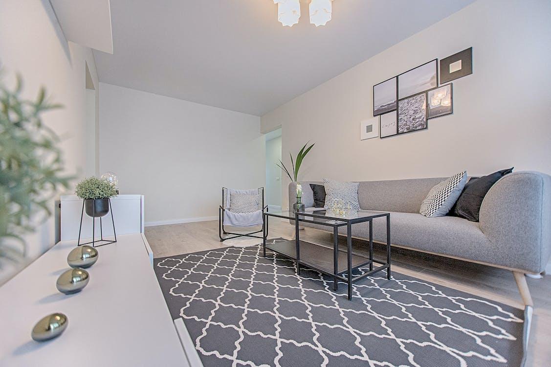 Three Gray Ornaments on White Wooden Desk Inside Living Room