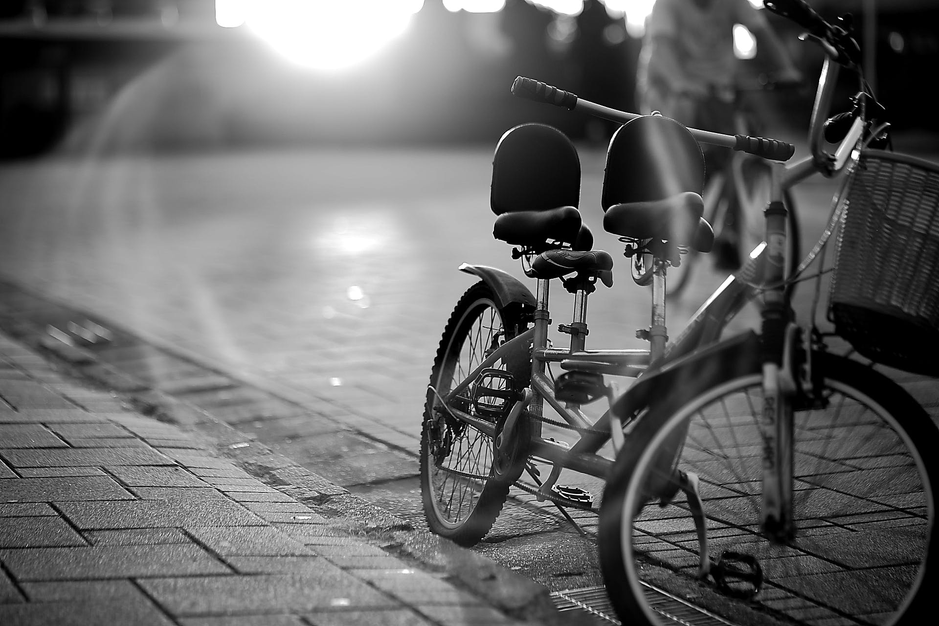 Tandem Bicycle on Sidewalk in Greyscale Photography