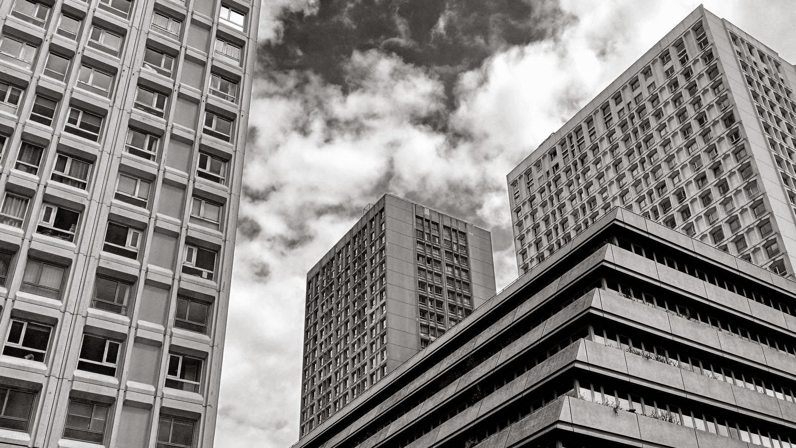 Greyscale Photography of High Rise Building