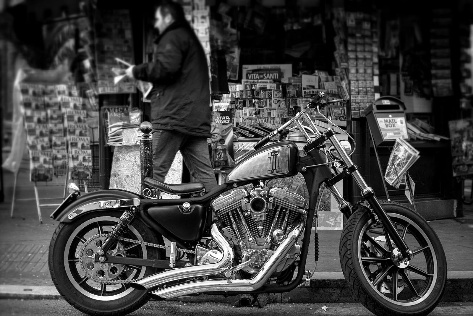 Grayscale Photo of a Cruiser Motorcycle