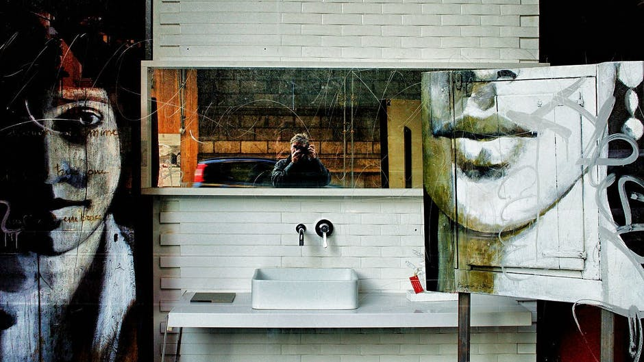 White Ceramic Rectangular Sink Under White Wooden Frame Rectangular Mirror