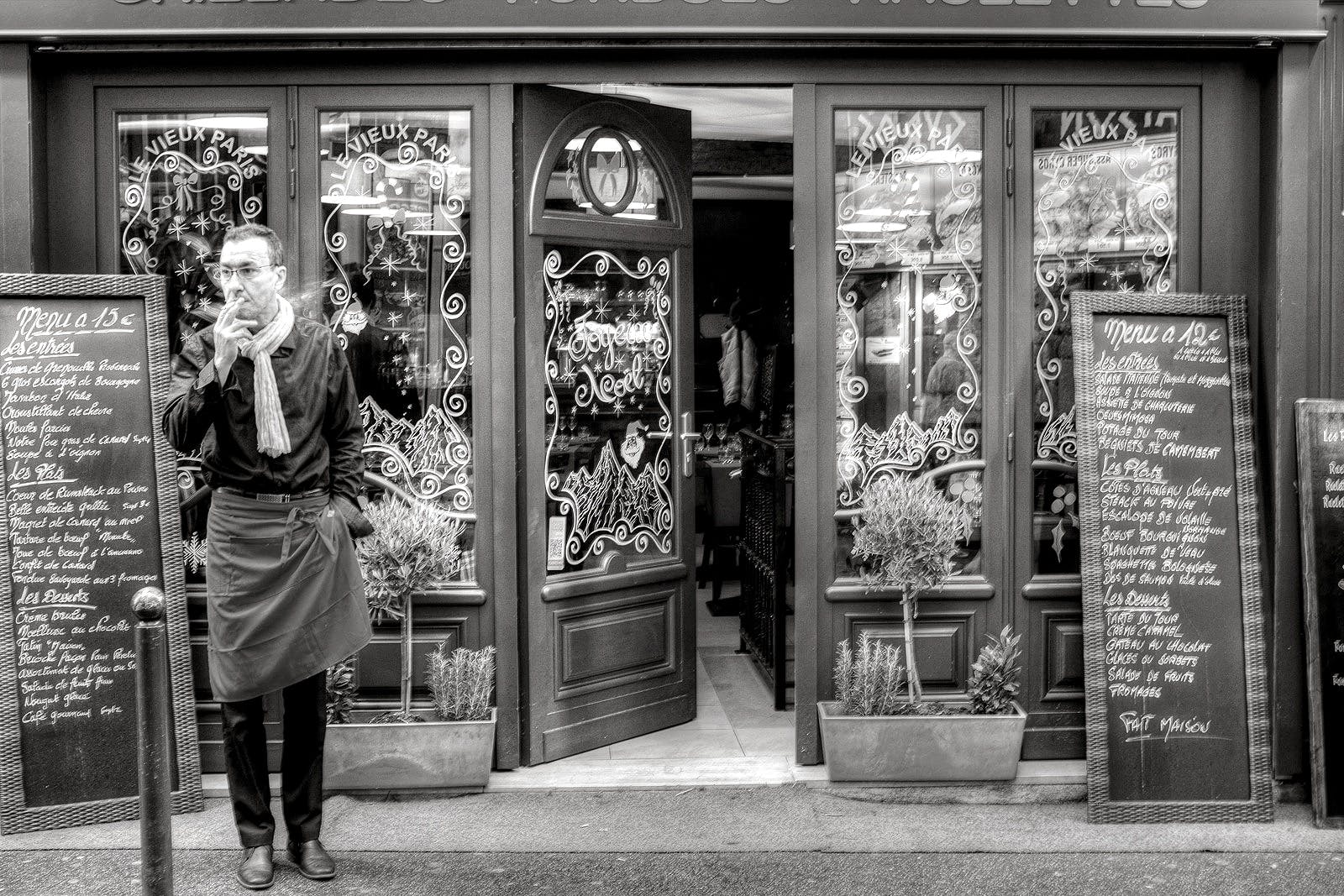 Grayscale Photography of Man Beside Store