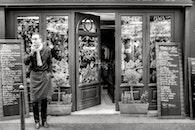 black-and-white, restaurant, man