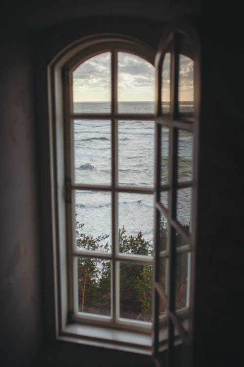 Photo of a Window Overlooking the Ocean