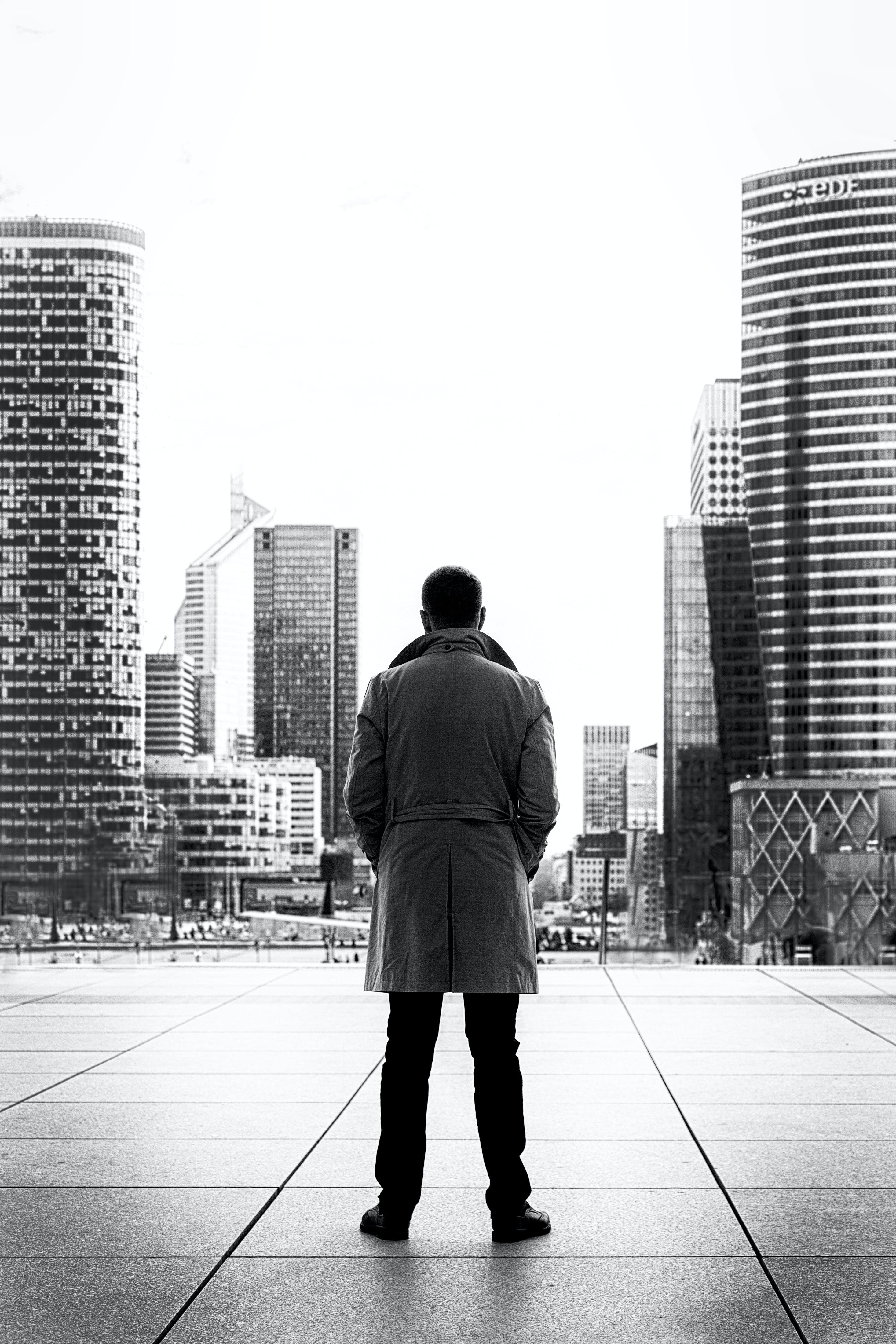 Monochrome Photo of Man Wearing Trench Coat