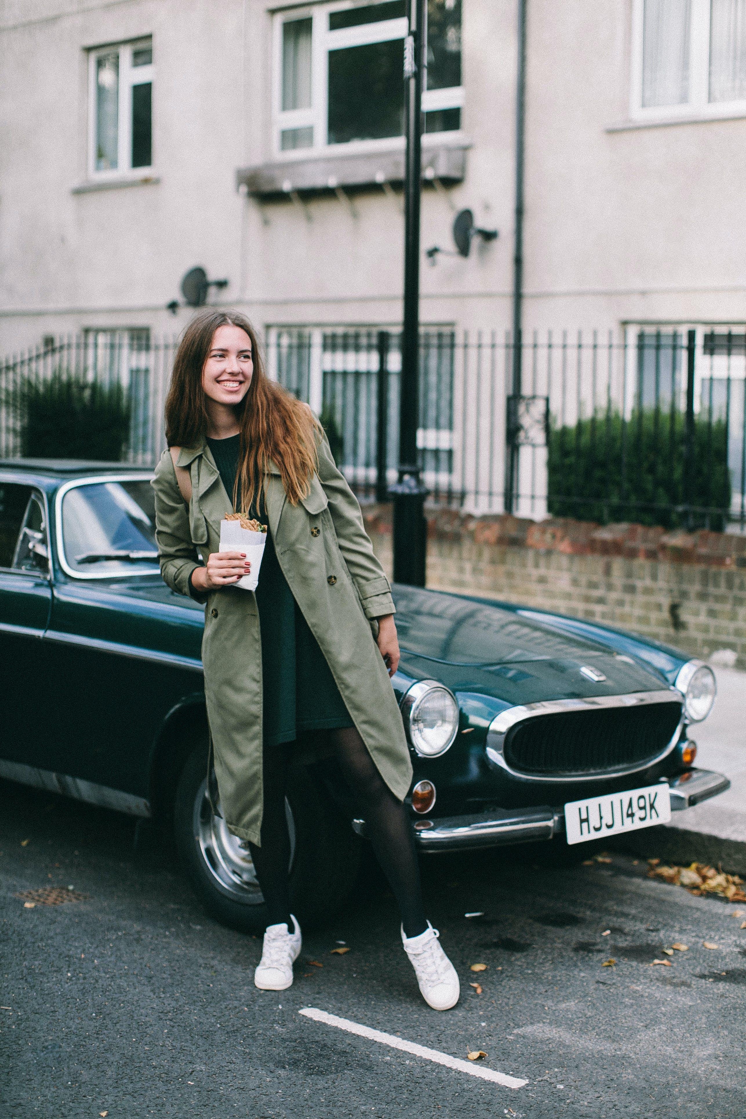 Woman Standing Beside Classic Car