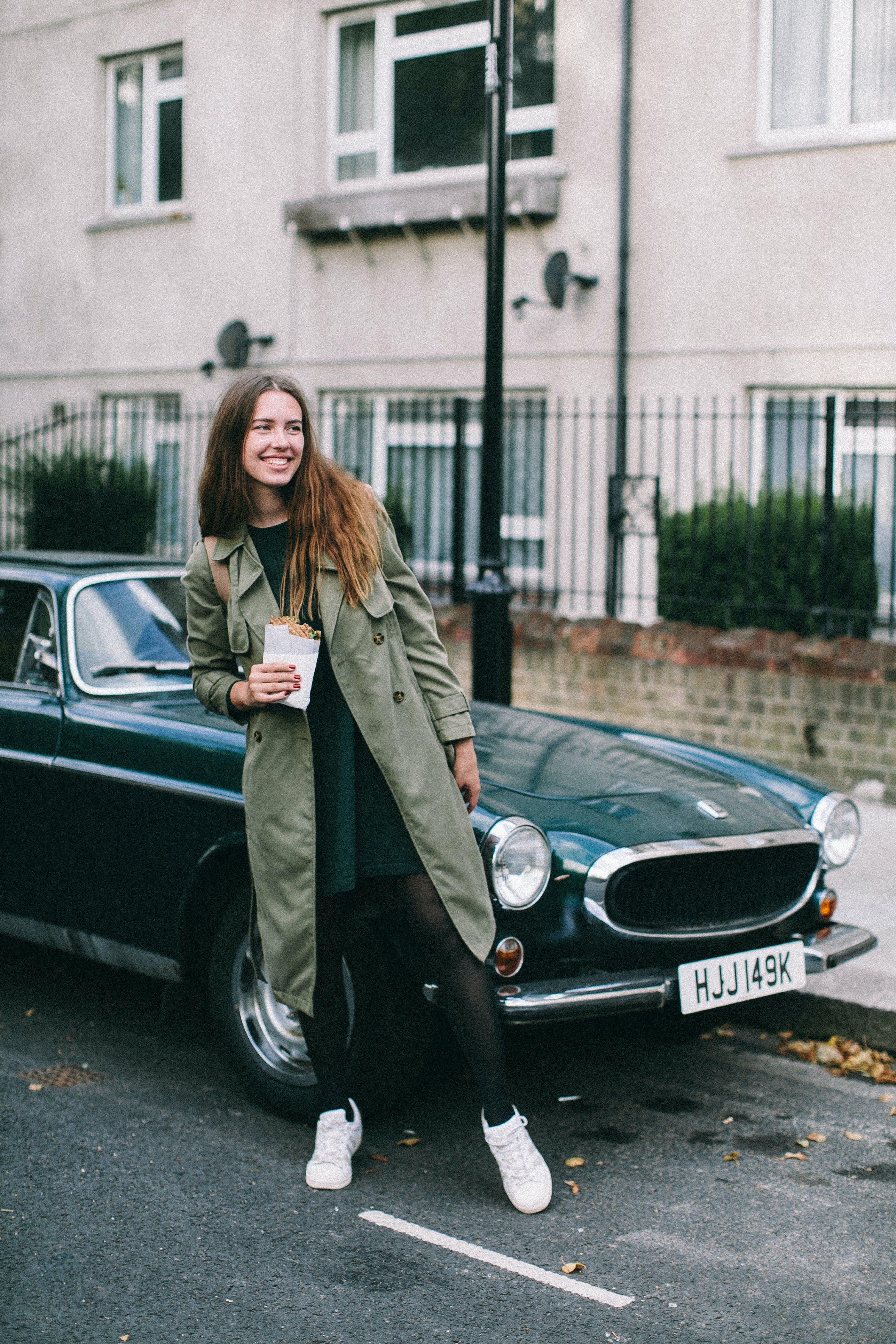 Woman Standing Beside Classic Car
