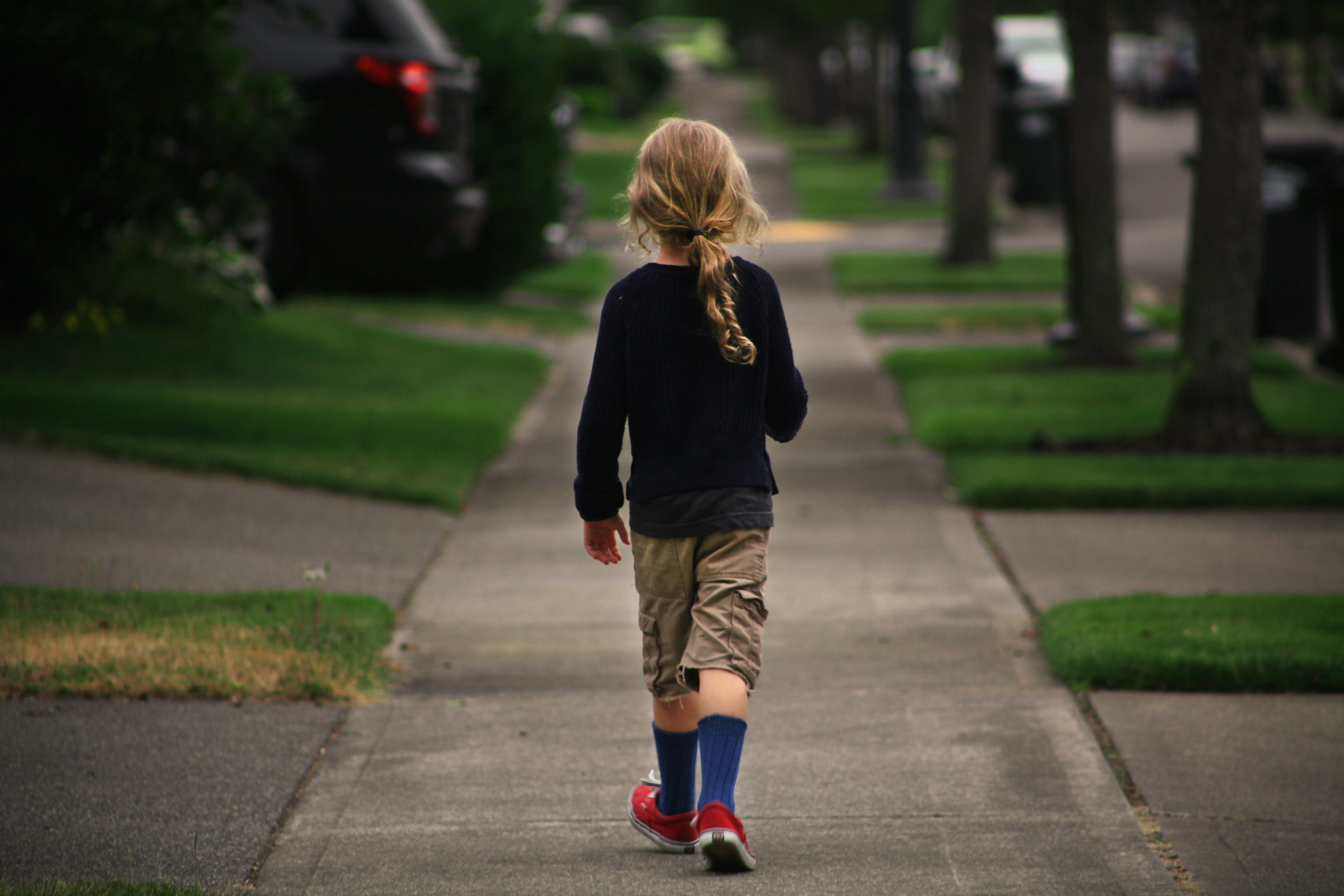 Free stock photo of boy walking sidewalk street