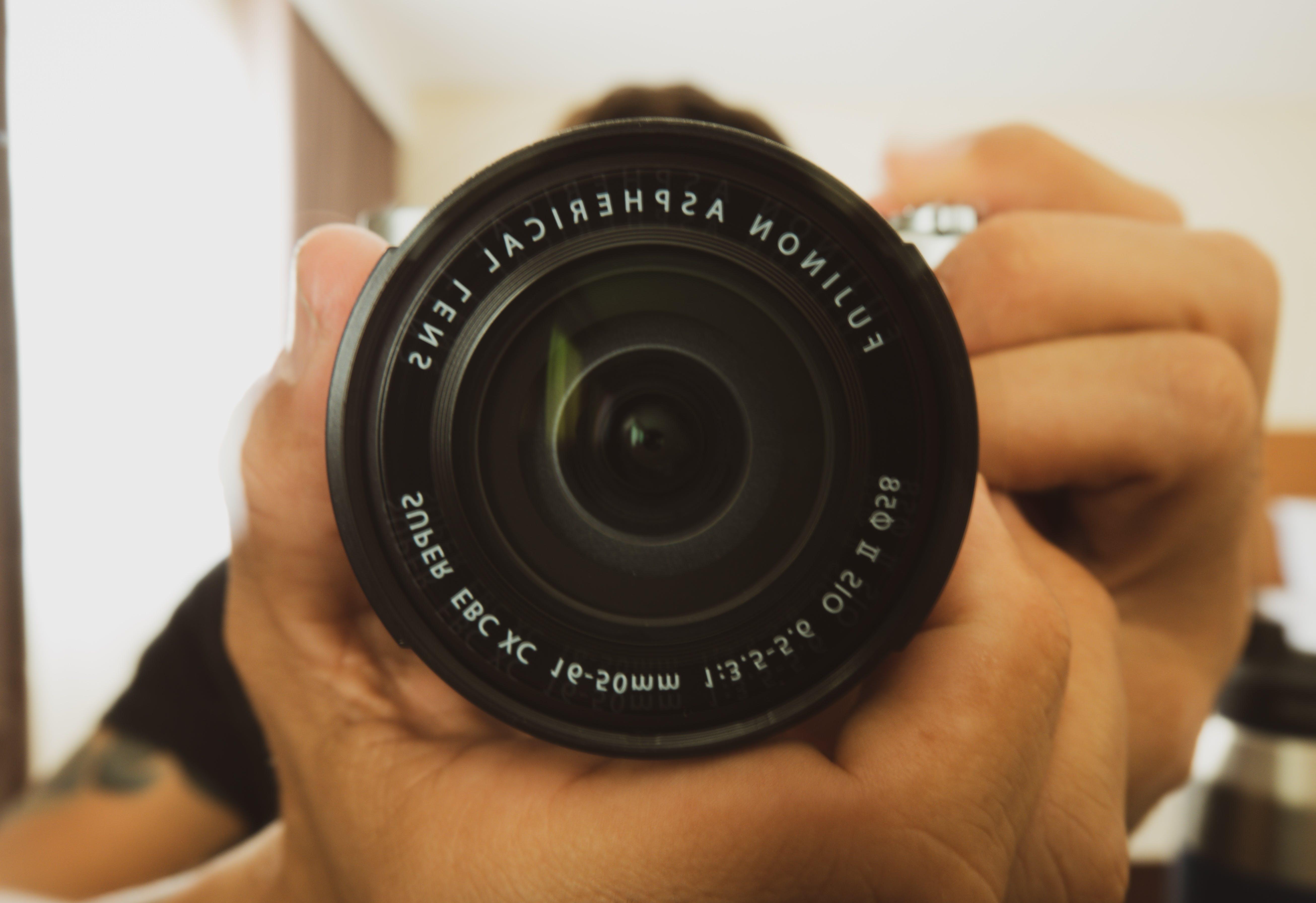 Free stock photo of camera, camera lens, lens, photographer