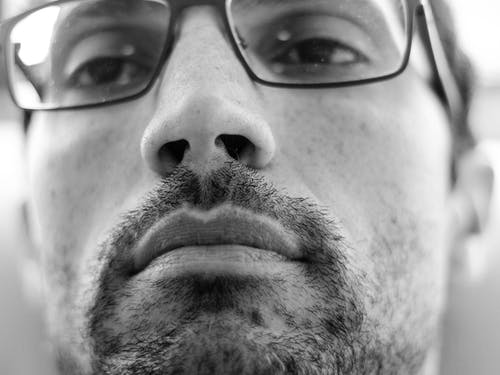 Grayscale Photo of Man in Eyeglasses