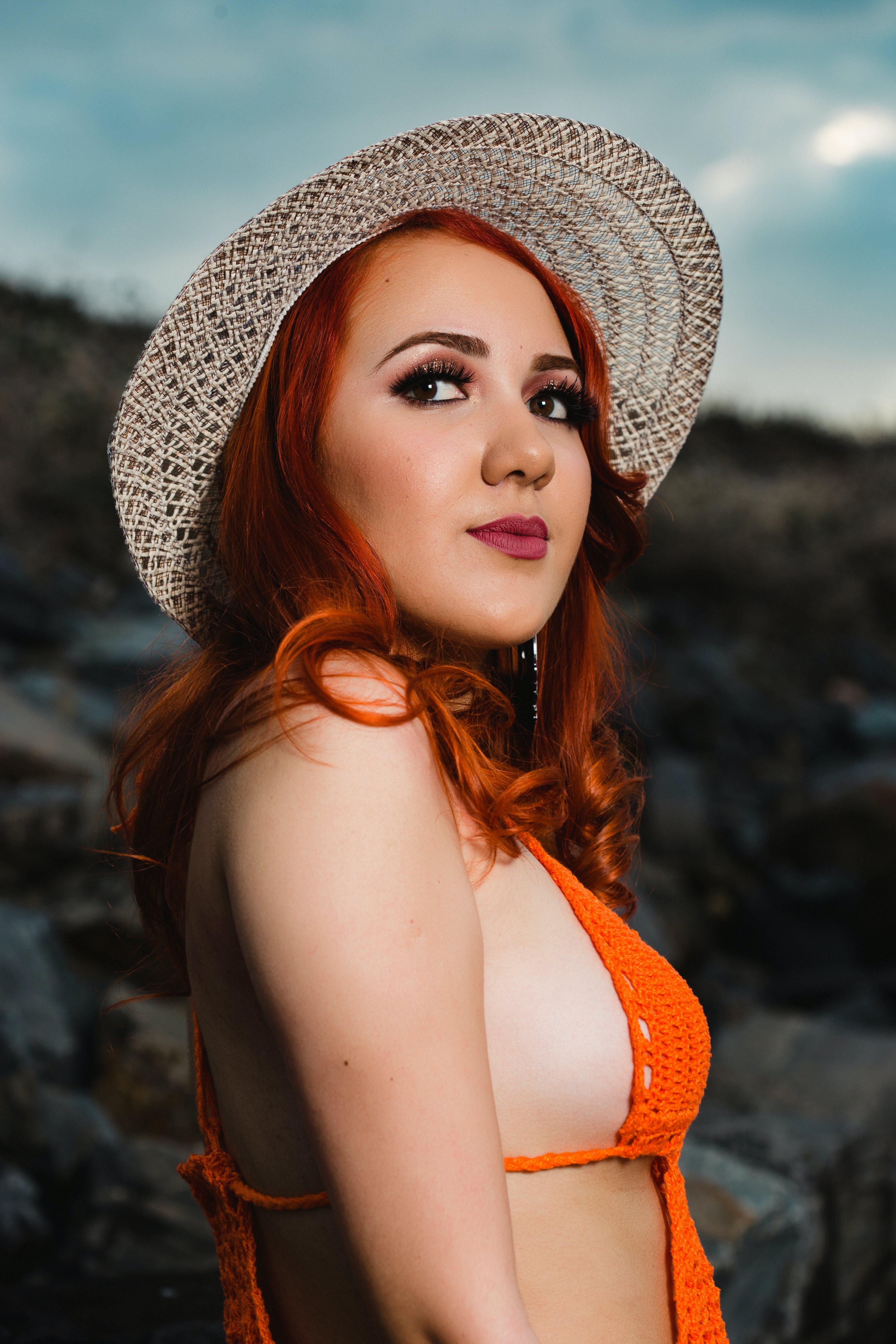 Woman in Orange Top