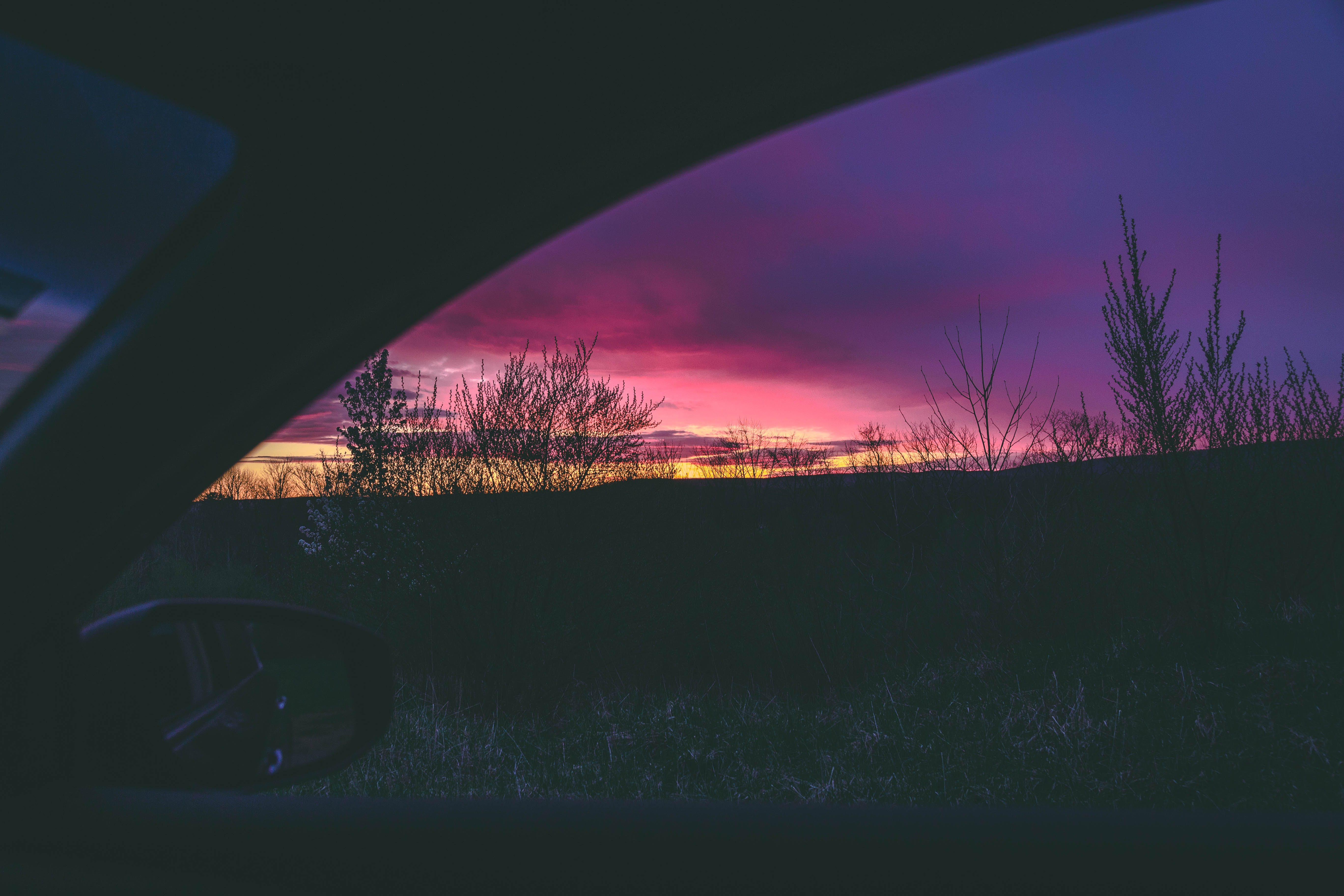 Person Inside Vehicle during Golden Hour