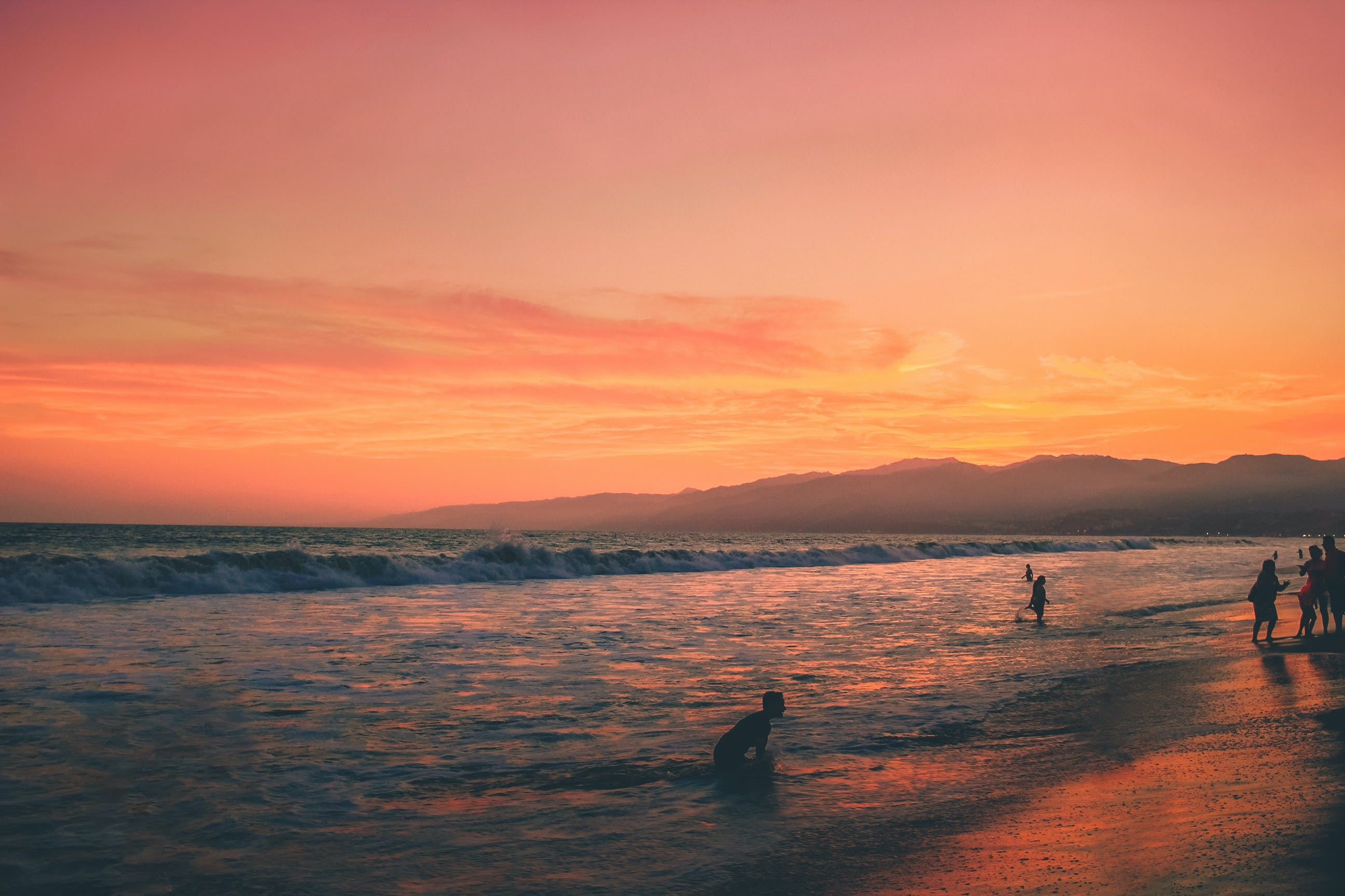 Photo of People On Seashore During Sunset
