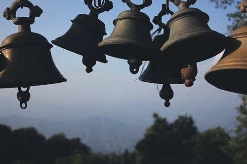 Photography of Black Hanging Bells during Daytime