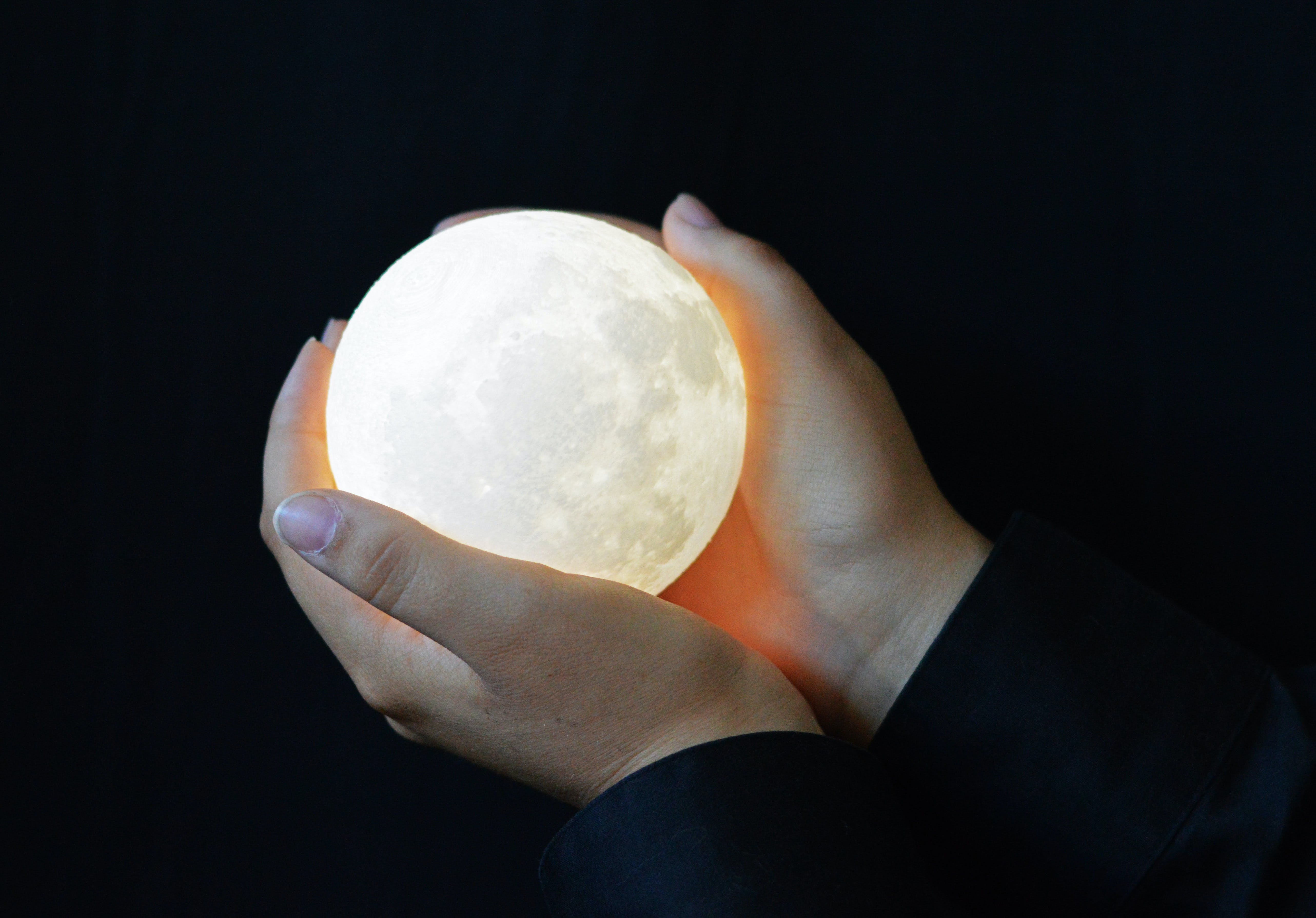 Free stock photo of full moon, hands, hands holding full moon