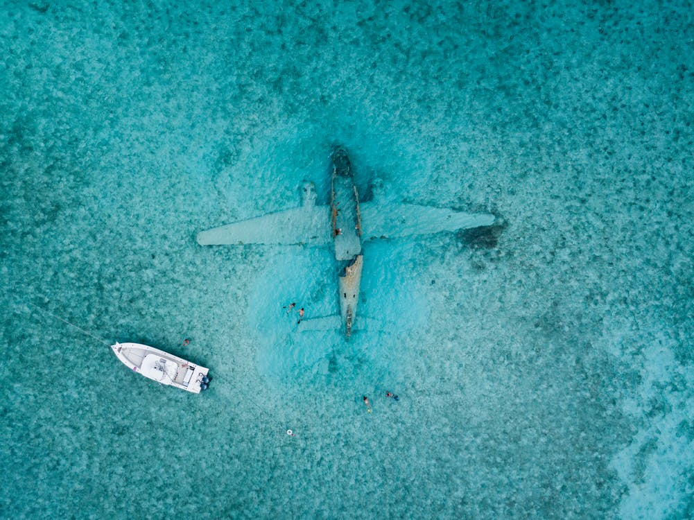 Top View Photo of Boat Near Airplane