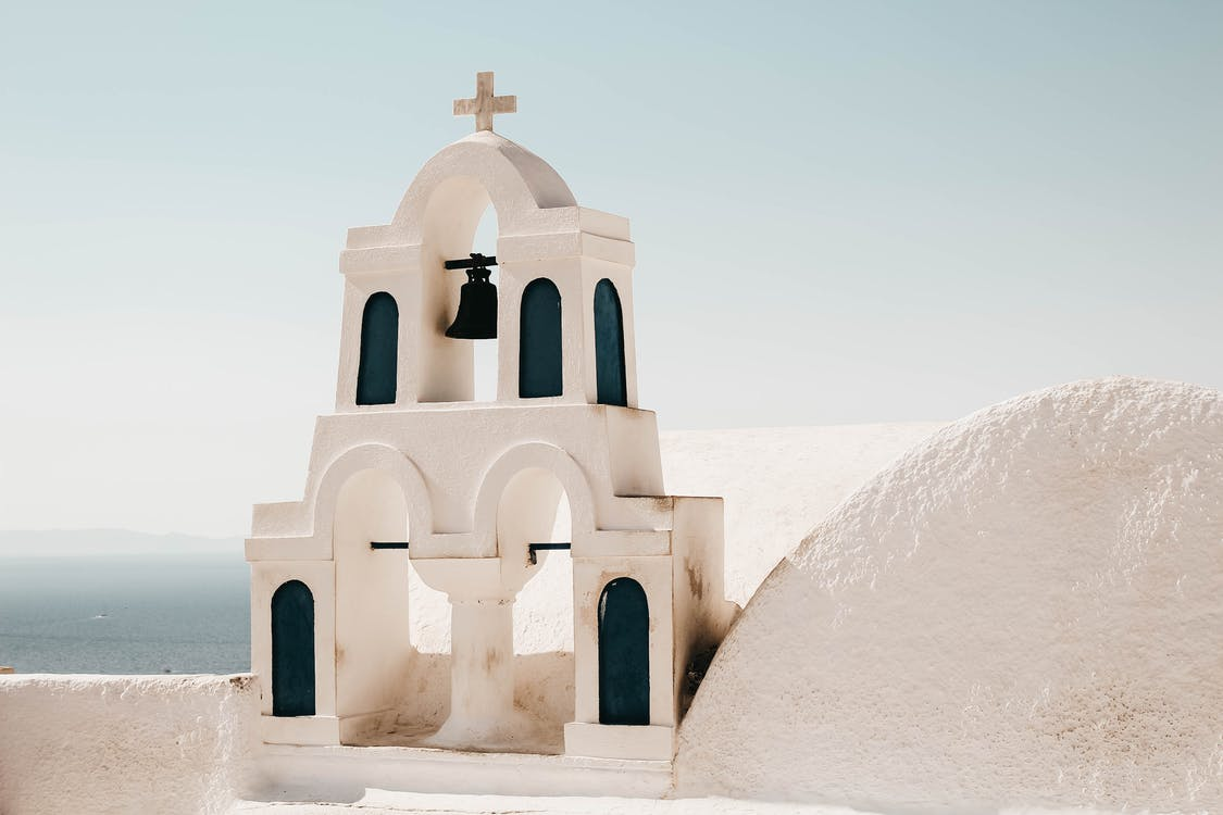 White Concrete Church With Cross on Top