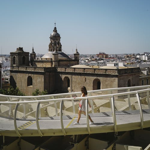 Photo Of Woman Walking On A Bridge