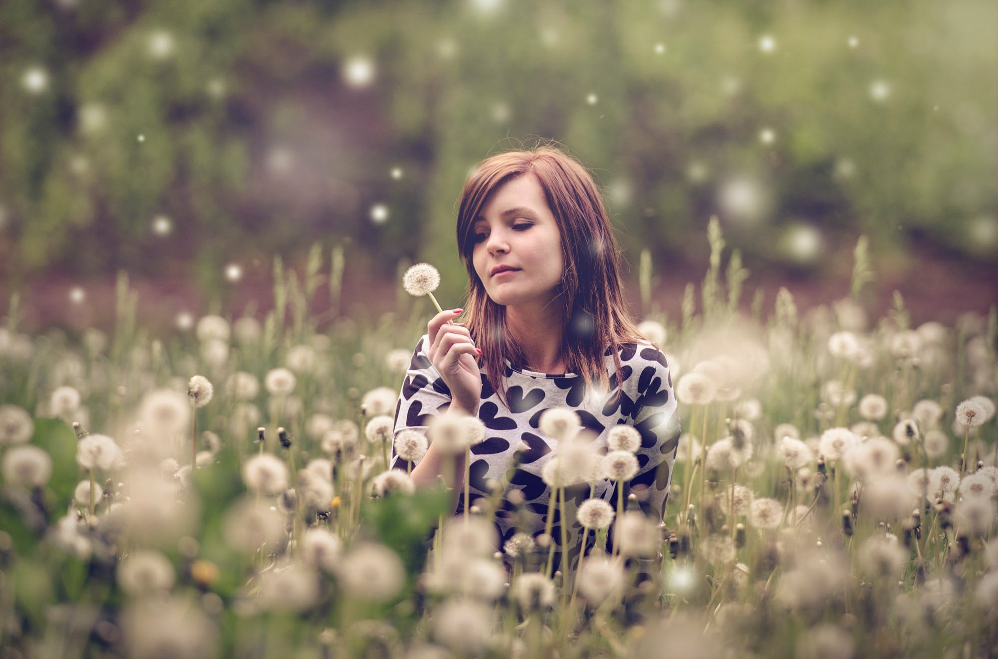 Woman Sitting in a Field of Flowers