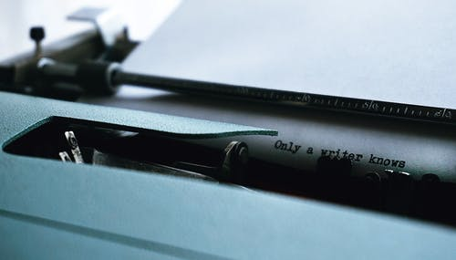 Close-up Photography of Typewriter With Only a Writer Knows Text on Printer Paper