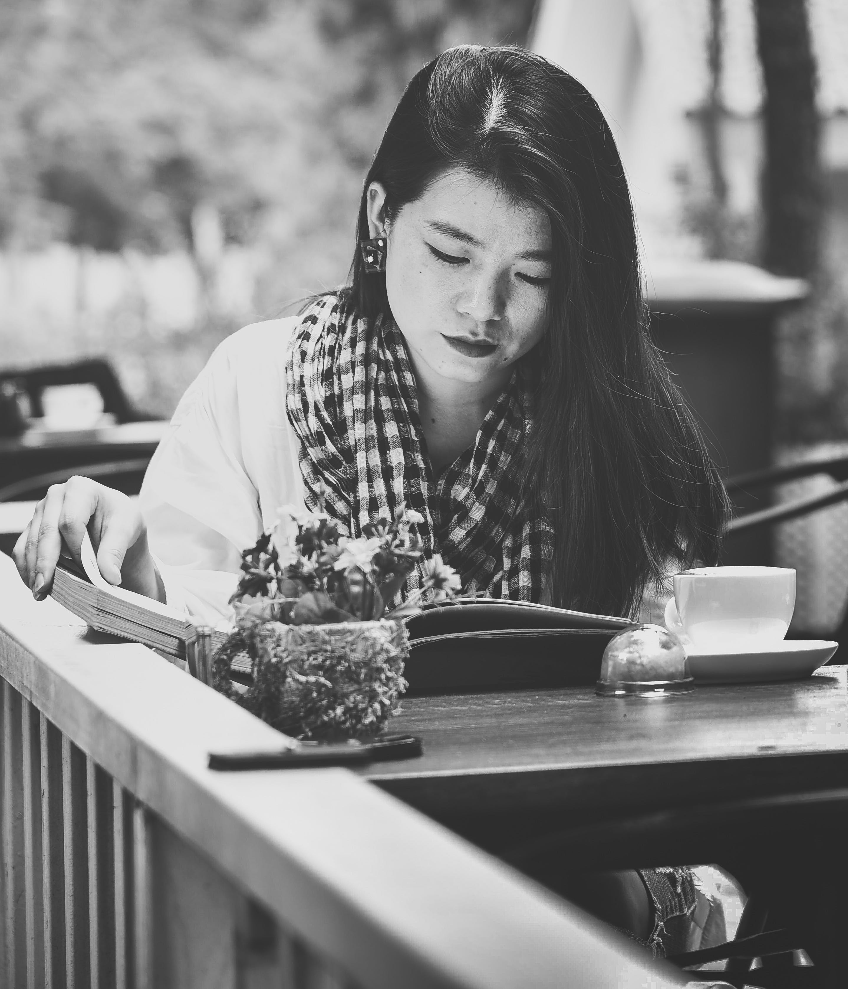 Grayscale Photography of Woman Reading