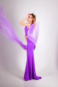 Photo Shoot of Woman Wearing Purple Sleeveless Long Dress