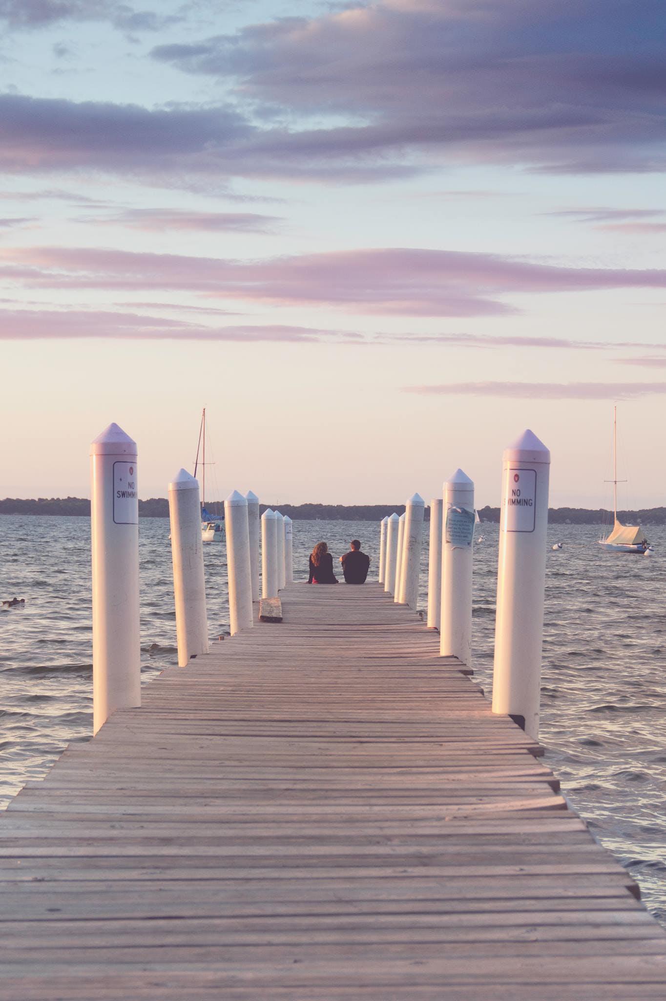 Free stock photo of couple, lake, pier, sailboats