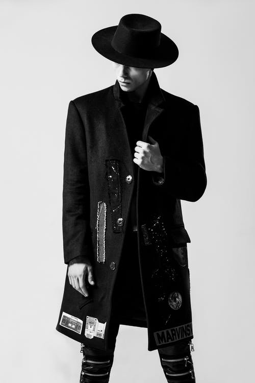Man Wearing Black Hat and Black Coat