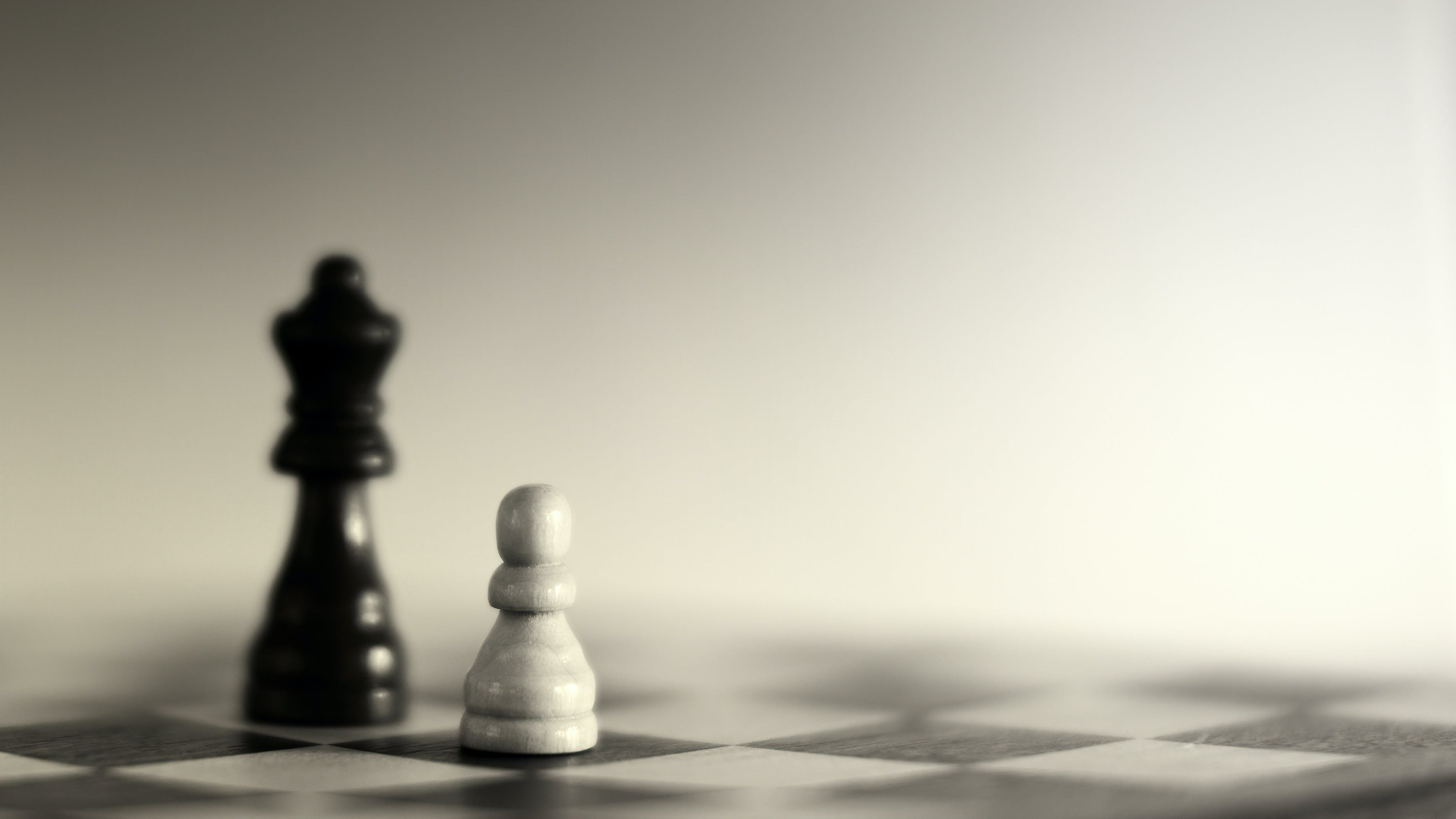 Grayscale Photography of Two Chess Pieces