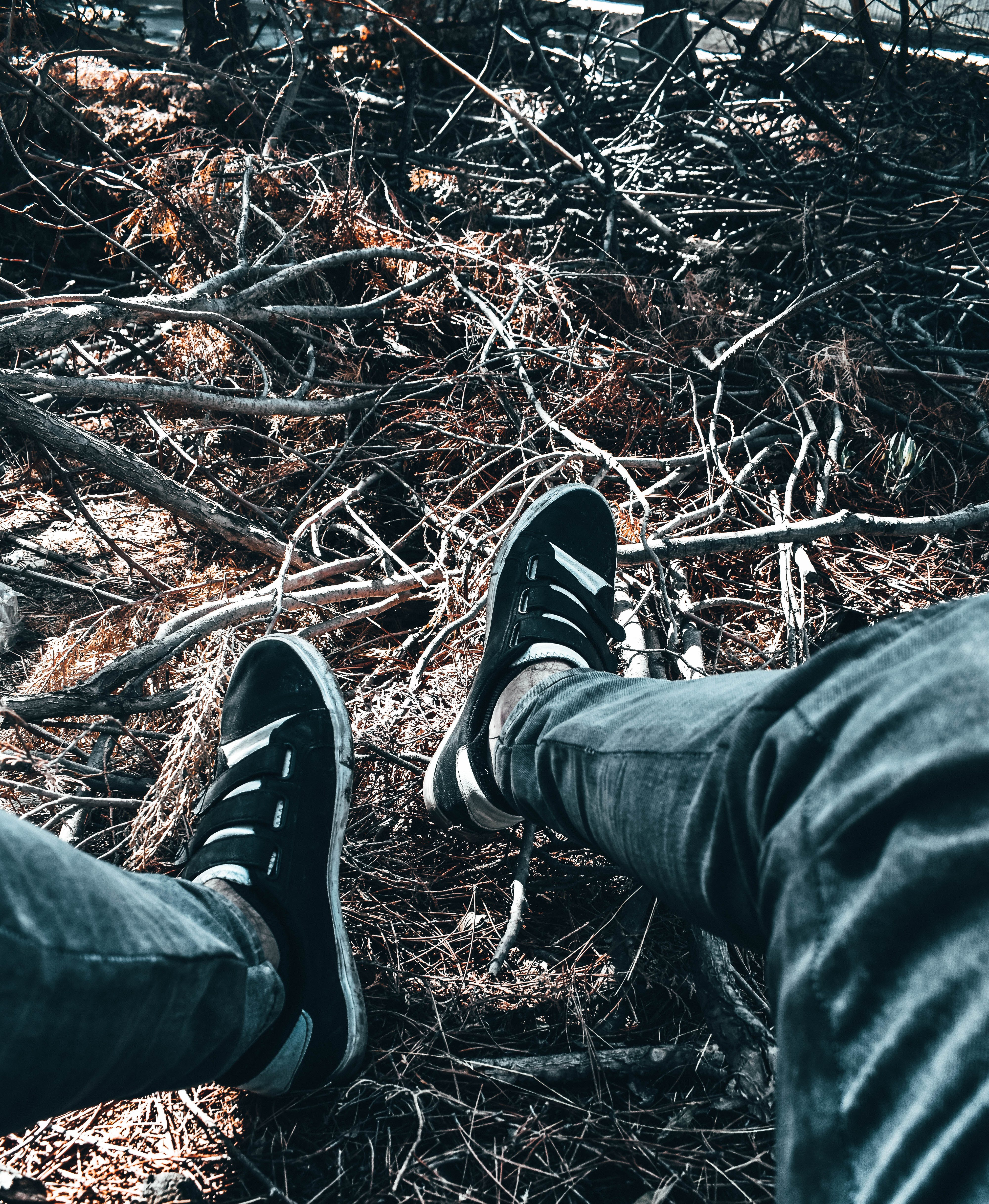 Person Feet on Twigs