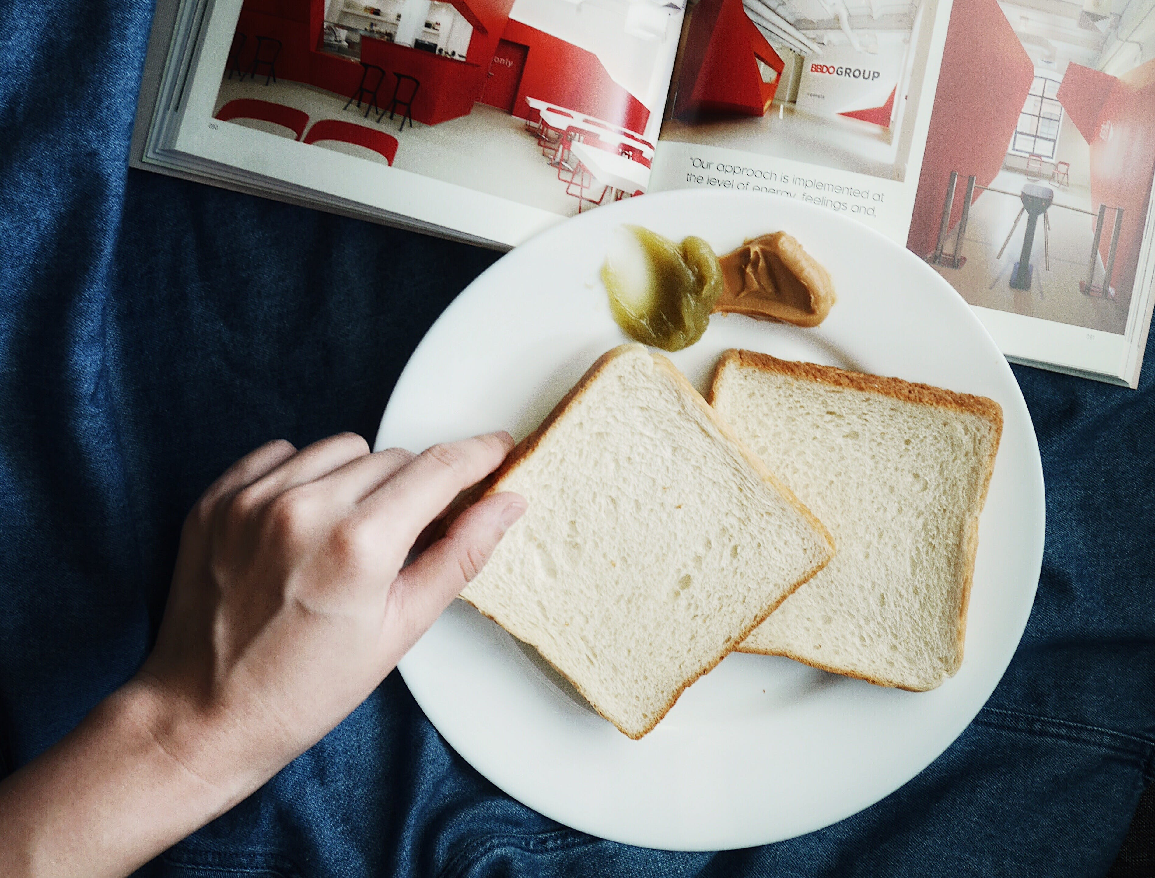 Person Touching the Bread on Plate