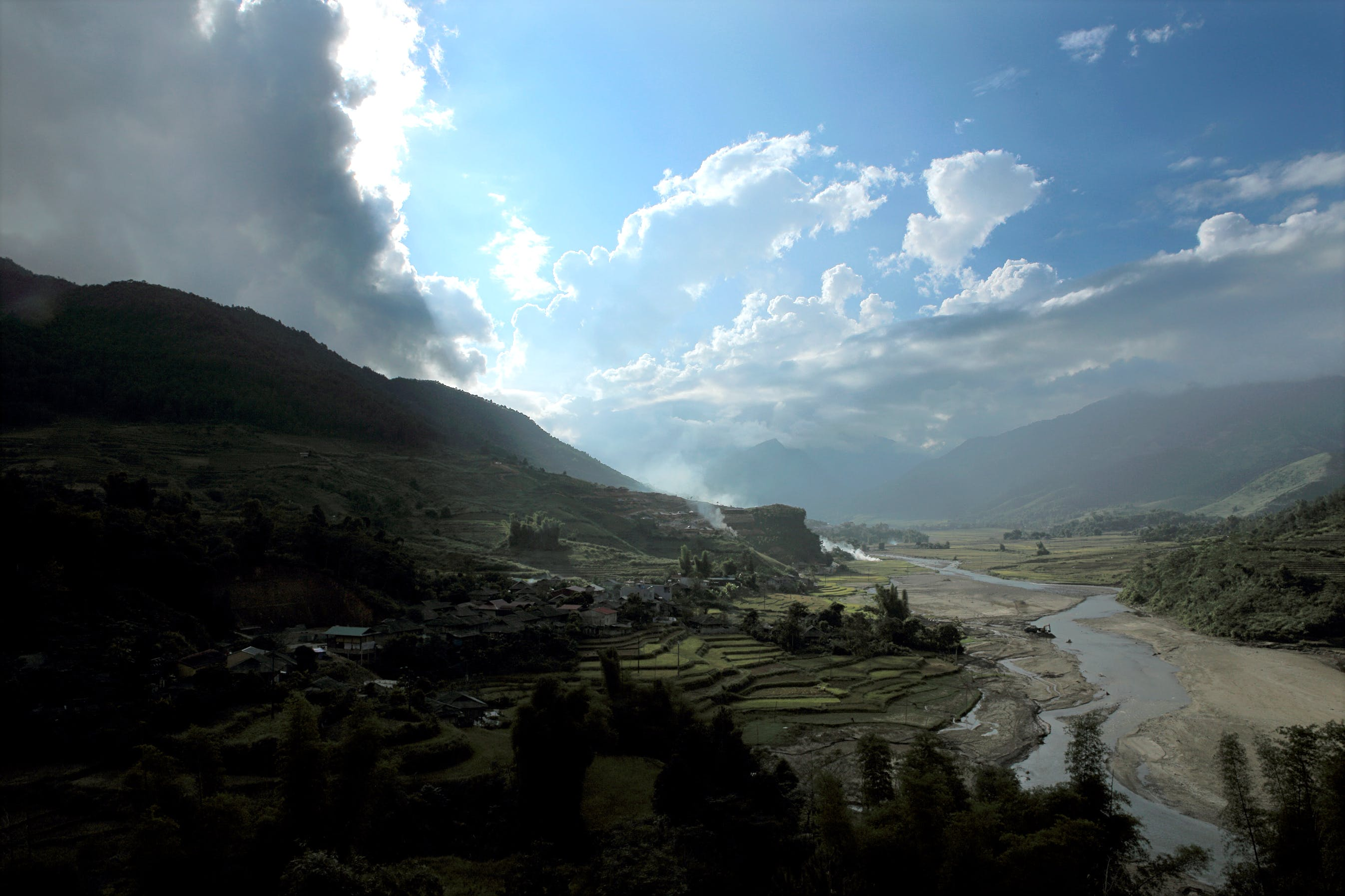 Rice Terraces Under White Clouds and Blue Sky
