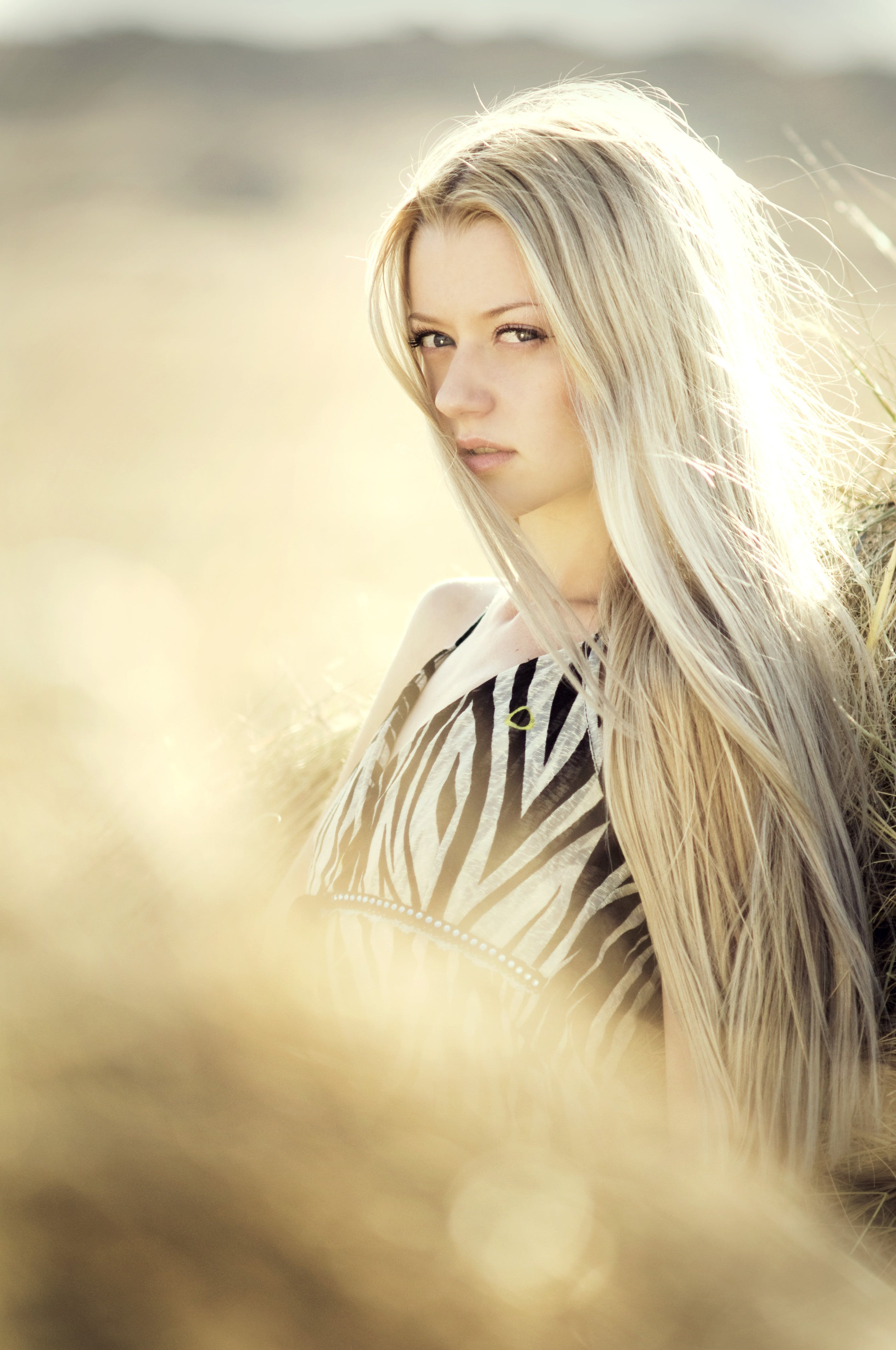 Blonde Haired Woman in Open Field Photoshoot during Daytime