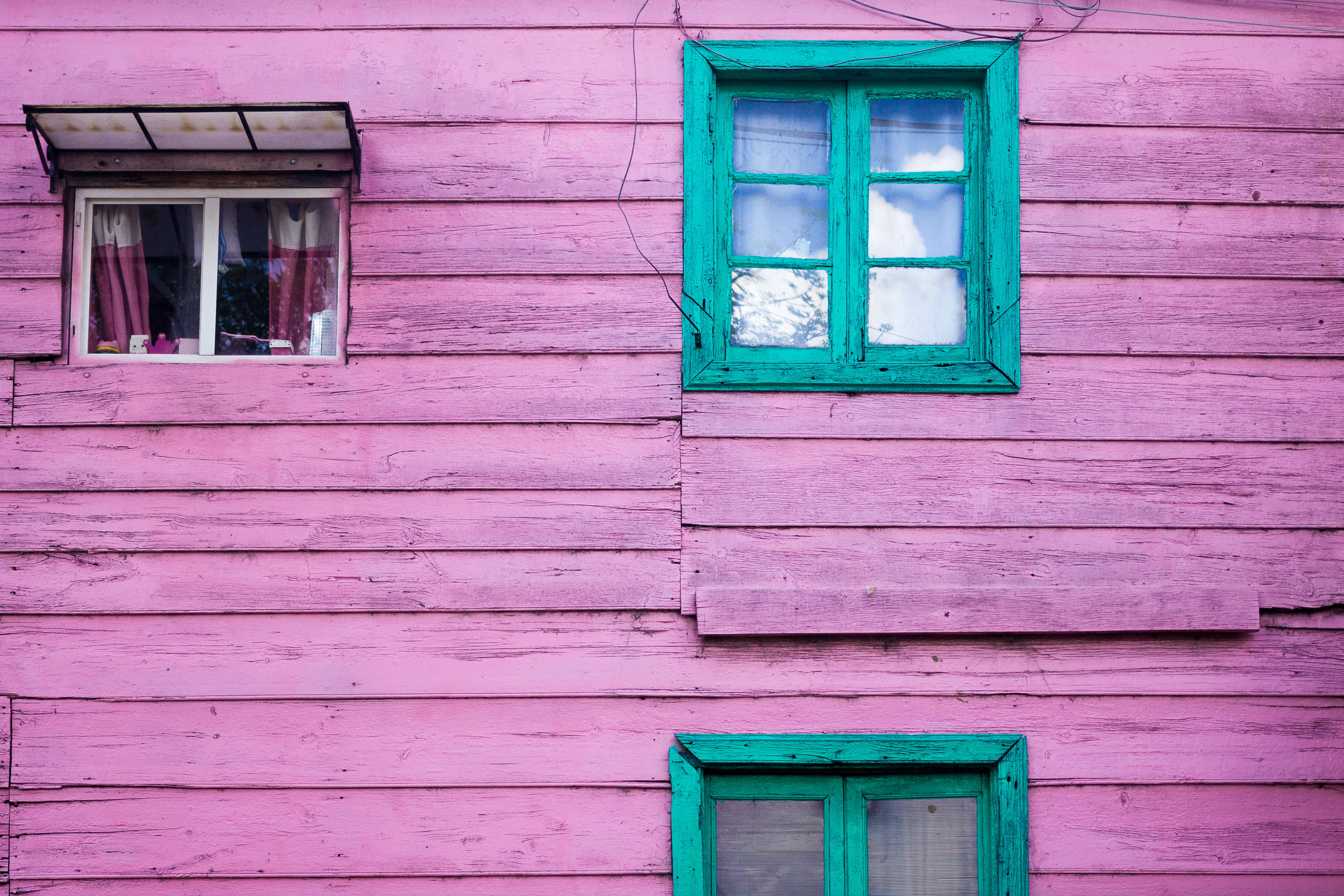 Purple Wooden House With Green Wooden Windows