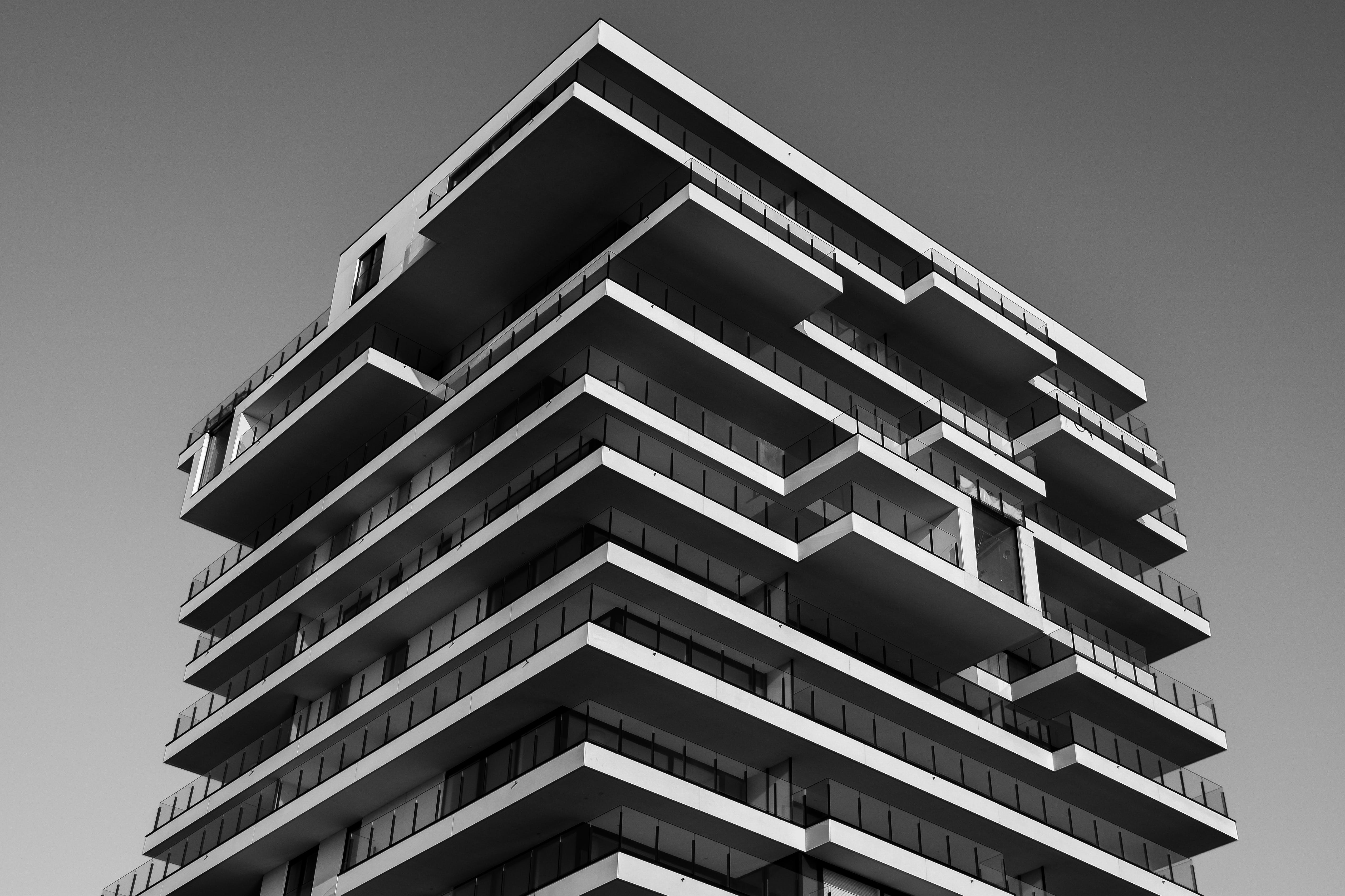 Grayscale Photo of Concrete Building