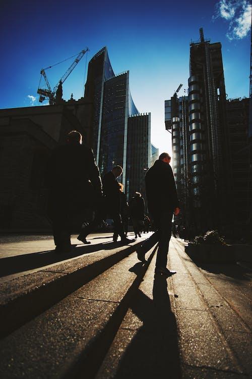 Men Walking Near Buildings