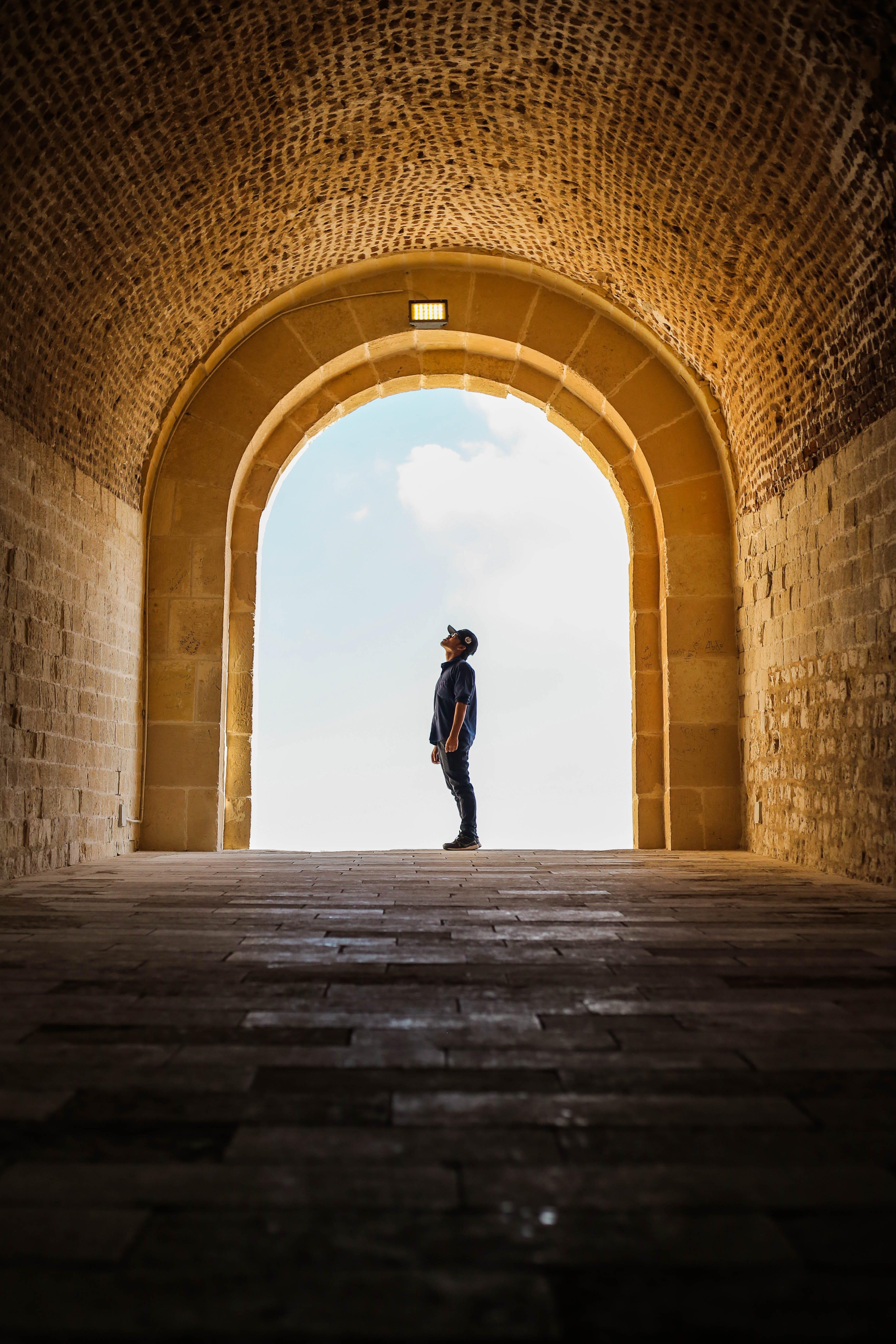 Man Standing Inside A Temple