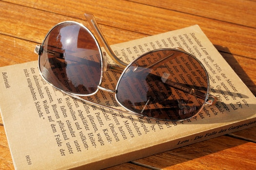 Silver Steel Framed Aviator Sunglasses on Top of Book during Daytime