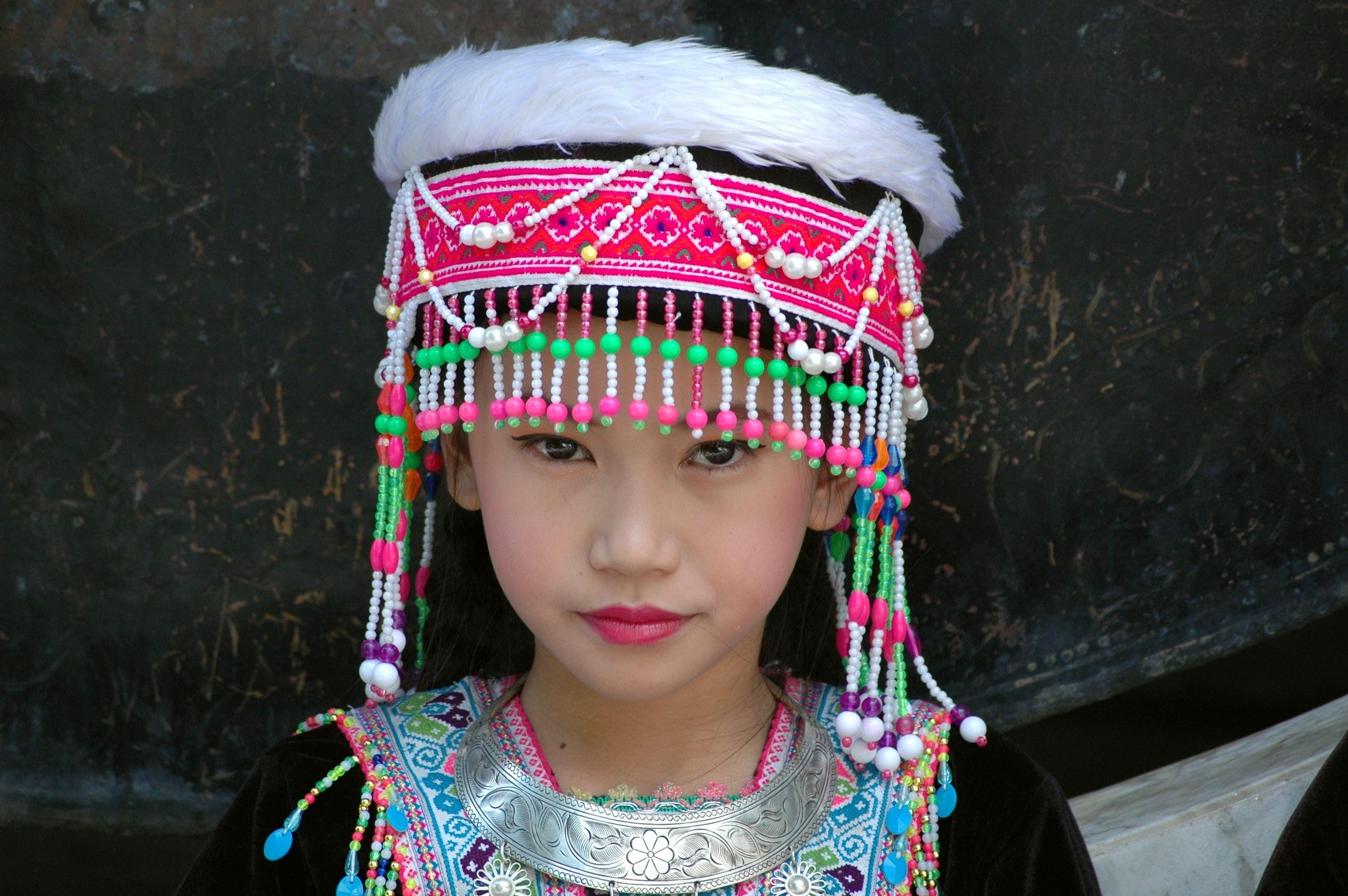 Girl Wearing Pink and Green Beaded Cap