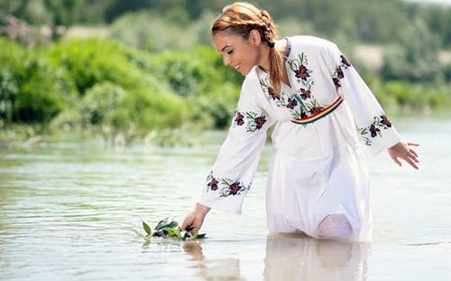 Woman in White Dress in the Water at Daytime